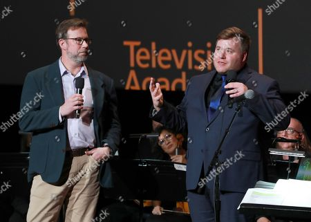 """Benjamin Wallfisch, Kevin Mohs. Kevin Mohs, left, and Benjamin Wallfisch participate in the Television Academy member event """"Perfect Harmony: A Live Performance Celebrating the Impact of Music in Documentaries"""" at the Saban Media Center's Wolf Theatre on in North Hollywood, Calif"""