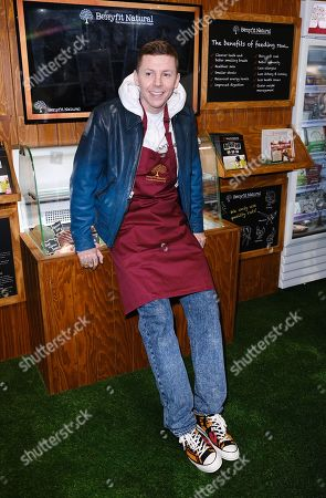 Professor Green on the Benyfit Natural stand on day 1 of Crufts