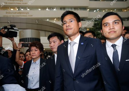 Thai Raksa Chart Party leader Preechapol Pongpanich (2-R) walks with his fellows party members after the Constitutional Court ordered the dissolution of the party for nominating a Thai princess as a prime minister candidate, at the Constitutional Court in Bangkok, Thailand, 07 March 2019. Thai Constitutional Court ordered the dissolution of Thai Raksa Chart Party for nominating Princess Ubolratana as its prime minister candidate for the general election. The court also decided to impose a political ban on 14 party executives for 10 years.