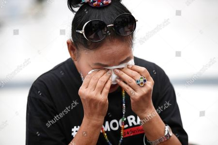 A supporter weeps after the Constitutional Court ordered the dissolution of the party for nominating a Thai princess as a prime minister candidate, at the Constitutional Court in Bangkok, Thailand, 07 March 2019. Thai Constitutional Court ordered the dissolution of Thai Raksa Chart Party for nominating Princess Ubolratana as its prime minister candidate for the general election. The court also decided to impose a political ban on 14 party executives for 10 years.