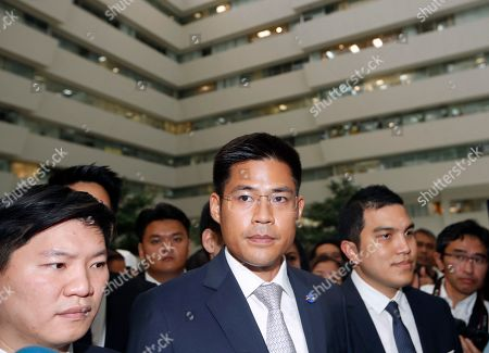 Thai Raksa Chart Party leader Preechapol Pongpanich (C) looks on while standing next to his fellow party members after the Constitutional Court ordered the dissolution of the party for nominating a Thai princess as a prime minister candidate, at the Constitutional Court in Bangkok, Thailand, 07 March 2019. Thai Constitutional Court ordered the dissolution of Thai Raksa Chart Party for nominating Princess Ubolratana as its prime minister candidate for the general election. The court also decided to impose a political ban on 14 party executives for 10 years.