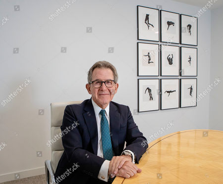 Lord John Browne with a series of black and white pictures by American photographer Aaron Siskind called 'Pleasures and Terrors of Levitation'
