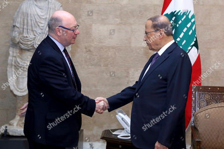 Michel Aoun, Alistair Burt. In this photo released by Lebanon's official government photographer, Dalati Nohra, Lebanese President Michel Aoun, right, shakes hands with Britain's Foreign Office Minister Alistair Burt, at the presidential palace, in Beirut, Lebanon, . Aoun spoke up in defense of the country's militant Hezbollah group, telling Burt that the group's allegiances in the region do not affect internal Lebanese politics