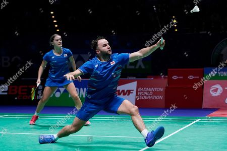 England's Ben Lane (R) and Jessica Pugh (L) in action during their doubles Round of 16 match against England's Gabrielle Adcock and Chris Adcock at the All England Open Badminton Championships at the National Indoor Arena, Birmingham, Britain, 07 March 2019.