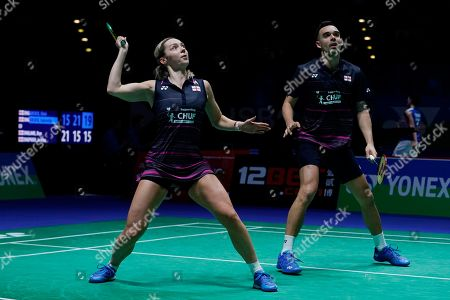 England's Gabrielle Adcock (L) and Chris Adcock (R) in action during their doubles Round of 16 match against England's Ben Lane and Jessica Pugh at the All England Open Badminton Championships at the National Indoor Arena, Birmingham, Britain, 07 March 2019.