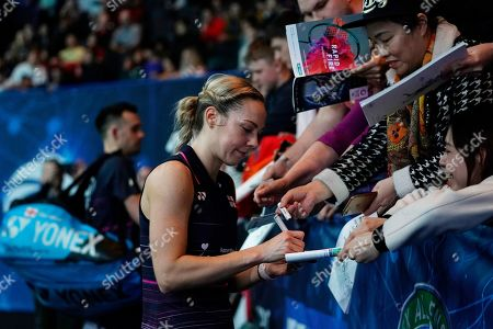 England's Gabrielle Adcock signs autographs after her doubles Round of 16 match with teammate Chris Adcock against England's Ben Lane and Jessica Pugh at the All England Open Badminton Championships at the National Indoor Arena, Birmingham, Britain, 07 March 2019.