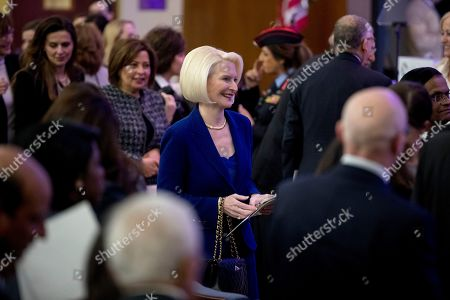 Callista Gingrich, U.S. Ambassador to the Holy See, center, departs following the 2019 International Women of Courage Awards at the Department of State in Washington