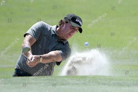 Phil Mickelson hits out of a bunker onto the second green during the first round of the Arnold Palmer Invitational golf tournament, in Orlando, Fla