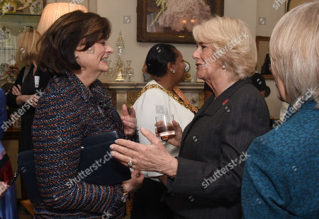 Cherie Blair chats with Camilla Duchess of Cornwall, President of WOW - Women of the World, as she hosts a reception for the organisation at Clarence House