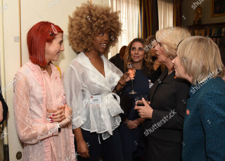 Chidera Eggerue (2nd L) chats with Camilla Duchess of Cornwall, President of WOW - Women of the World, as she hosts a reception for the organisation at Clarence House
