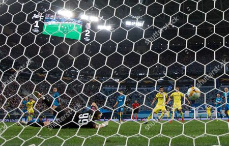 Stock Image of Zenit's goalkeeper Andrey Lunyov dives but fails to stop a shot by Villarreal's Manu Morlanes during the Europa League round of 16, 1st leg soccer match between Zenit St.Petersburg and Villarreal at the Saint Petersburg stadium, in St.Petersburg, Russia