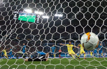 Stock Picture of Zenit's goalkeeper Andrey Lunyov dives but fails to stop a shot by Villarreal's Manu Morlanes during the Europa League round of 16, 1st leg soccer match between Zenit St.Petersburg and Villarreal at the Saint Petersburg stadium, in St.Petersburg, Russia