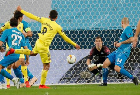 Zenit's goalkeeper Andrey Lunyov makes a save during the Europa League round of 16, 1st leg soccer match between Zenit St.Petersburg and Villarreal at the Saint Petersburg stadium, in St.Petersburg, Russia