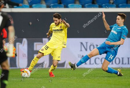 Villarreal's Miguel Llambrich, left, and Zenit's Daler Kuzyayev challenge the ball during the Europa League round of 16, 1st leg soccer match between Zenit St.Petersburg and Villarreal at the Saint Petersburg stadium, in St.Petersburg, Russia