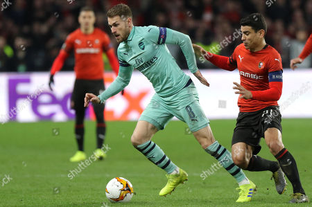 Stade Rennes's Benjamin Andre (R) and Arsenal's Aaron Ramsey (L) in action during the UEFA Europa League round of 16 first leg soccer match between Stade Rennes vs Arsenal in Rennes, France, 07 March 2019.