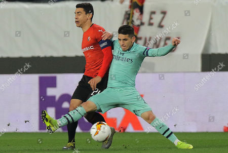 Stade Rennes's Benjamin Andre (L) and Arsenal's Lucas Torreira (R) in action during the UEFA Europa League round of 16 first leg soccer match between Stade Rennes vs Arsenal in Rennes, France, 07 March 2019.
