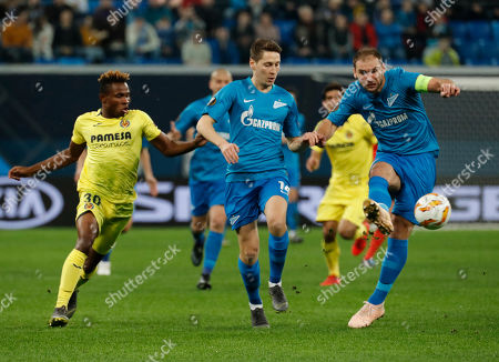 Branislav Ivanovic (R) and Daler Kuzyaev (C) of Zenit in action against Samu Chukwueze (L) of Villarreal during the UEFA Europa League Round of 16, first leg soccer match between Zenit and Villarreal in St. Petersburg, Russia, 07 March 2019.