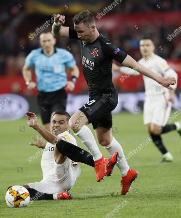 Sevilla's defender Gabriel Mercado (L) vies for the ball against Slavia Prague's midfielder Jaromír Zmrhal (R during the UEFA Europe League round of 16 first leg match between Sevilla FC and SK Slavia Prague at Ramon Sanchez Pizjuan stadium in Seville, Andalusia, Spain, 07 March 2019.