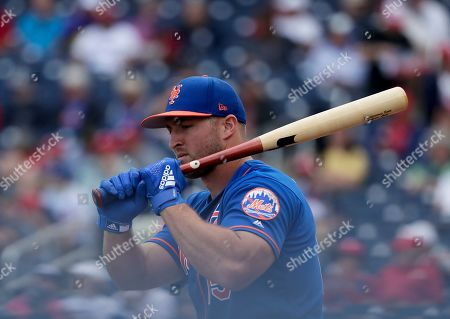 New York Mets's Tim Tebow (15) practices batting before an exhibition spring training baseball game against the Washington Nationals, in West Palm Beach, Fla