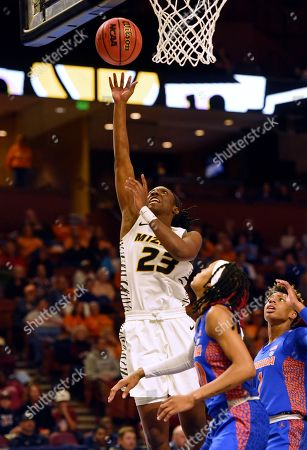 Missouri's Amber Smith shoots ahead of Florida's Delicia Washington during the first half of an NCAA college basketball game at the Southeastern Conference women's tournament, in Greenville, S.C