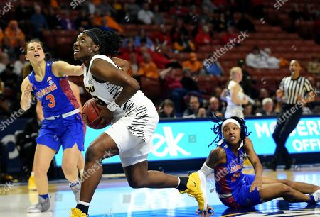 Missouri's Amber Smith to the basket past Florida's Delicia Washington, right, and Funda Nakkasoglu during the second half of an NCAA college basketball game at the Southeastern Conference women's tournament, in Greenville, S.C