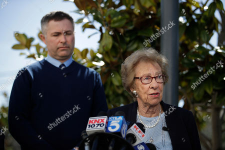 Sean Boulton, Eva Schloss. Joined by Newport Harbor High School Principal Sean Boulton, left, Eva Schloss, the stepsister of Anne Frank and a Holocaust survivor, talks to reporters during a news conference, in Newport Beach, Calif. Schloss met Thursday with Southern California high school students who were photographed giving Nazi salutes around a swastika formed by drinking cups at a party. Schloss said the students apologized for their behavior and indicated they didn't realize what it really meant