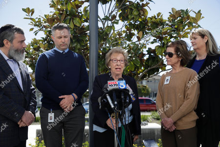 Sean Boulton, Eva Schloss, Reuven Mintz. Joined by Rabbi Reuven Mintz, left, and Newport Harbor High School principal Sean Boulton, second from left, Eva Schloss, center, the stepsister of Anne Frank and a Holocaust survivor, talks to reporters during a news conference, in Newport Beach, Calif. Schloss met Thursday with Southern California high school students who were photographed giving Nazi salutes around a swastika formed by drinking cups at a party. Schloss said the students apologized for their behavior and indicated they didn't realize what it really meant
