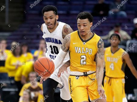 Indiana State's Christian Williams (10) and Valparaiso's Deion Lavender (2) chase the ball during the second half of an NCAA college basketball game in the first round of the Missouri Valley Conference men's tournament, in St. Louis
