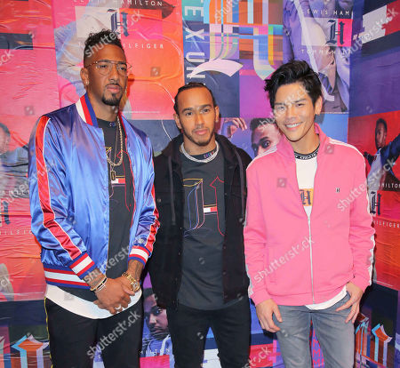 Stock Photo of Jerome Boateng, Lewis Hamilton and Jacky Heung