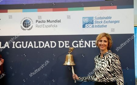 Stock Picture of Vice President of the National Securities Market Commission, Ana Maria Martinez-Pina, rings the bell during a ceremony for the gender equality at Madrid's Stock Exchange held as part of an international initiative on the occasion of the Women's Day, in Madrid, Spain. Stock Exchanges of 65 different countries are to participate in the global 'bell ringings' organized by the Sustainable Stock Exchanges Initiative to raise awareness of the pivotal role the private sector can play in advancing gender equality to achieve the UN?s Sustainable Development Goal 5.