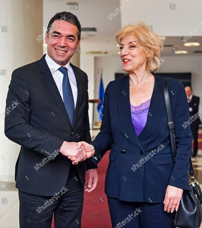 North Macedonian Foreign Minister Nikola Dimitrov (L) welcomes Greece's Alternate Foreign Minister Sia Anagnostopoulou