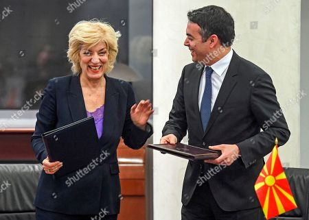 Greece's Alternate Foreign Minister Sia Anagnostopoulou   (L) and North Macedonian Foreign Minister Nikola Dimitrov (R) as they are signing the agreement to open a new border crossing between Greece and North Macedonia in Skopje