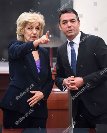 Stock Picture of Greece's Alternate Foreign Minister Sia Anagnostopoulou   (L) and North Macedonian Foreign Minister Nikola Dimitrov (R) as they are signing the agreement to open a new border crossing between Greece and North Macedonia in Skopje