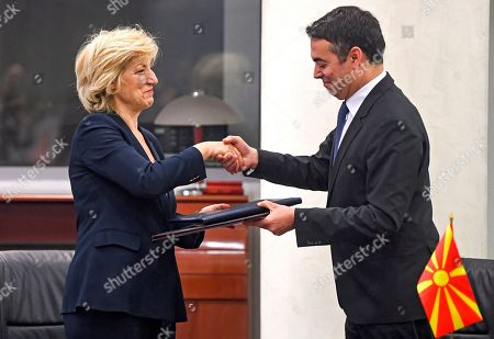 Greece's Alternate Foreign Minister Sia Anagnostopoulou   (L) shakes hands with North Macedonian Foreign Minister Nikola Dimitrov (R) as they are signing the agreement to open a new border crossing between Greece and North Macedonia in Skopje