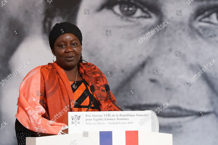 Cameroonian activist Aissa Doumara Ngatansou delivers a speech after she received the Simone Veil prize, at the Elysee Palace, in Paris,. France's first Simone Veil prize goes to a Cameroonian activist Aissa Doumara Ngatansou who has worked against forced marriages and other violence against girls and women