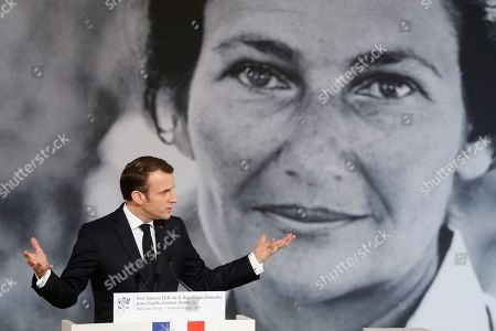 Stock Photo of France's President Emmanuel Macron delivers a speech during the presentation of the Simone Veil prize, at the Elysee Palace, in Paris, France, 08 March 2019. France?s first Simone Veil prize goes to a Cameroonian activist Aissa Doumara Ngatansou who has worked against forced marriages and other violence against girls and women. International Women's Day (IWD) is a global day that celebrates women's achievements in socially, economically, culturally and politically and also an invitation for all elements of society to accelerate gender equality.