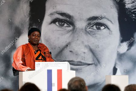 Stock Picture of Cameroonian activist Aissa Doumara Ngatansou delivers a speech after she received the Simone Veil prize, at the Elysee Palace, in Paris, France, 08 March 2019. France?s first Simone Veil prize goes to a Cameroonian activist Aissa Doumara Ngatansou who has worked against forced marriages and other violence against girls and women. International Women's Day (IWD) is a global day that celebrates women's achievements in socially, economically, culturally and politically and also an invitation for all elements of society to accelerate gender equality.
