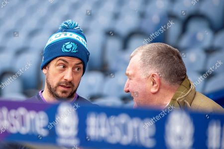 Greg Laidlaw (#21) of Scotland speaks with former Scotland player Ian McLauchlan during the Captain's training run for Scotland at BT Murrayfield, Edinburgh ahead of the Guinness 6 Nations match against Wales