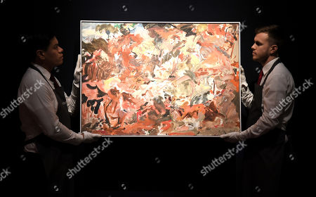 Christie's employee's with a Cecily Brown painting