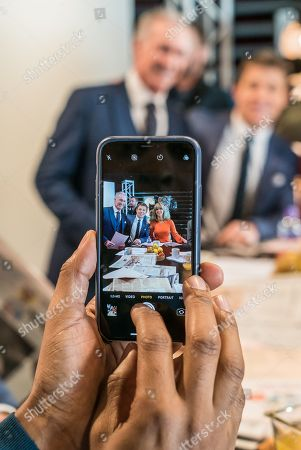 GOOD MORNING BRITAIN Andi Peters takes a photo of Dr Hillary Ben Shephard and Kate Garraway on his mobile phone
