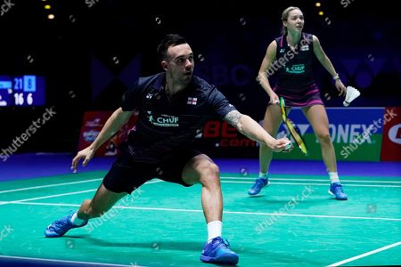 England's Chris Adcock (L) and Gabrielle Adcock (R) in action during their mixed doubles quarter final match against China's Zheng Siwei and Huang Yaqiong at the All England Open Badminton Championships at the National Indoor Arena, Birmingham, Britain, 08 March 2019.
