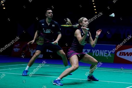 Stock Image of England's Chris Adcock (L) and Gabrielle Adcock (R) in action during their mixed doubles quarter final match against China's Zheng Siwei and Huang Yaqiong at the All England Open Badminton Championships at the National Indoor Arena, Birmingham, Britain, 08 March 2019.