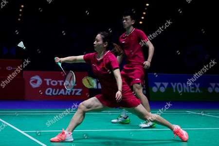 China's Zheng Siwei (R) and Huang Yaqiong (L) in action during their mixed doubles quarter final match against England's Chris Adcock and Gabrielle Adcock at the All England Open Badminton Championships at the National Indoor Arena, Birmingham, Britain, 08 March 2019.