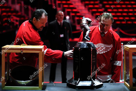 Former Detroit Red Wings players Joe Socur and Eddie Mio view memorabilia at a public viewing for Detroit Red Wings player Ted Lindsay, in Detroit. Lindsay pioneered the first NHL hockey players' union despite intense opposition from team management, began the tradition of taking the Stanley Cup closer to fans by skating it around the ice and refused to attend his own Hall of Fame induction ceremony because only men were allowed. Lindsay died Monday at the age of 93