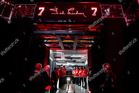 Pallbearers line up to move the casket of former Detroit Red Wings player Ted Lindsay at a public viewing, in Detroit. Lindsay pioneered the first NHL hockey players' union despite intense opposition from team management, began the tradition of taking the Stanley Cup closer to fans by skating it around the ice and refused to attend his own Hall of Fame induction ceremony because only men were allowed. Lindsay died Monday at the age of 93