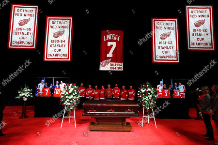 Pallbearers stand behind the casket of former Detroit Red Wings player Ted Lindsay at a public viewing, in Detroit. Lindsay pioneered the first NHL hockey players' union despite intense opposition from team management, began the tradition of taking the Stanley Cup closer to fans by skating it around the ice and refused to attend his own Hall of Fame induction ceremony because only men were allowed. Lindsay died Monday at the age of 93