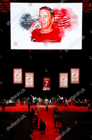 Mourners view the casket of former Detroit Red Wings player Ted Lindsay at a public viewing, in Detroit. Lindsay pioneered the first NHL hockey players' union despite intense opposition from team management, began the tradition of taking the Stanley Cup closer to fans by skating it around the ice and refused to attend his own Hall of Fame induction ceremony because only men were allowed. Lindsay died Monday at the age of 93