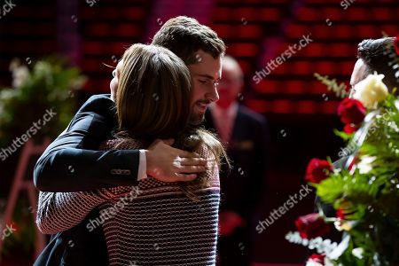 NHL Hall Of Famer Ted Lindsay Funeral. Dylan Larkin hugs Candice Berman, granddaughter of former Detroit Red Wings player Ted Lindsay, at a public viewing, in Detroit. Lindsay pioneered the first NHL hockey players' union despite intense opposition from team management, began the tradition of taking the Stanley Cup closer to fans by skating it around the ice and refused to attend his own Hall of Fame induction ceremony because only men were allowed. Lindsay died Monday at the age of 93