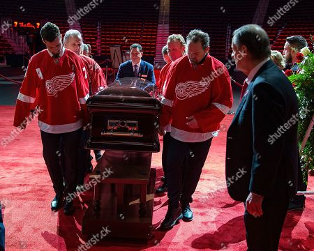 NHL Hall Of Famer Ted Lindsay Funeral. Pallbearers Dylan Larkin, left, and Joey Kocur, lead the casket of former Detroit Red Wings player Ted Lindsay at a public viewing, in Detroit. Lindsay pioneered the first NHL hockey players' union despite intense opposition from team management, began the tradition of taking the Stanley Cup closer to fans by skating it around the ice and refused to attend his own Hall of Fame induction ceremony because only men were allowed. Lindsay died Monday at the age of 93