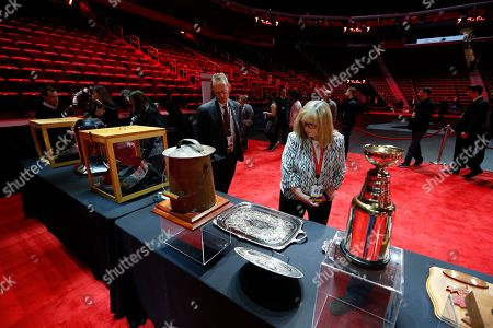 Stock Photo of Mourners view memorabilia at the public viewing of former Detroit Red Wings player Ted Lindsay, in Detroit. Lindsay pioneered the first NHL hockey players' union despite intense opposition from team management, began the tradition of taking the Stanley Cup closer to fans by skating it around the ice and refused to attend his own Hall of Fame induction ceremony because only men were allowed. Lindsay died Monday at the age of 93